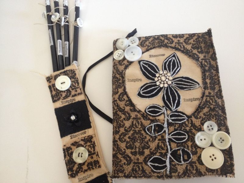 Button journal and pencils