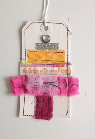 Gift tags made with fabric selvages
